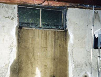 Water pouring out from a basement window in Rifle